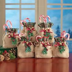 These charming burlap treat bags are the perfect way to give small presents or favors to your guests. Each has a drawstring top and is decorated with aHoliday Burlap Treat Bags - Set of Christmas Treat Bags Set from Collections Etc. Christmas Treat Bags, Homemade Christmas Gifts, Christmas Wrapping, Christmas Party Favors, Rustic Christmas, Handmade Christmas, Christmas Holidays, Magical Christmas, Country Christmas Ornaments