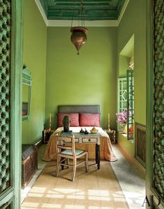 A 19th-century Persian light hangs in the Green Bedroom of a Marrakech riad designed by Chilean artist Claudio Bravo   archdigest.com