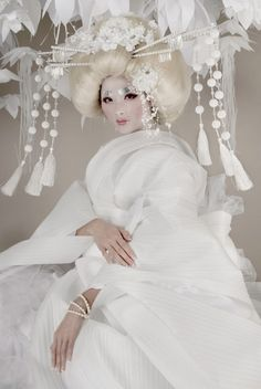 Geisha — When Gwen Brydson invited us to be a part of her 'Artist Series', of course we gladly accepted! Our paper flowers provided the background to Gwen's white-on-white Geisha vision. — Photos by Gwen Brydson, Model Kerry Lai Fatt, Wig & Makeup Sarah Blostein, Stylist Joshua Shier, Talent Aid Shaun Marq, Assistant Andrew Xu, Paper flower installation by Krona & Lion