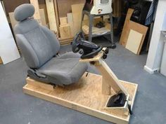 A petrolhead's home wouldn't be complete without a kick-ass racing simulator. Gaming Computer Setup, Gaming Room Setup, Gaming Chair, Racing Seats, Racing Wheel, Diy Arcade Cabinet, Racing Simulator, Black Dining Room Chairs, Video Game Rooms