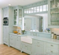 This Victorian style kitchen features blue painted cabinet