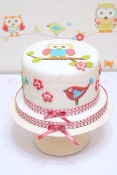 Owl cake idea- though maybe without all the pink decorations around the side