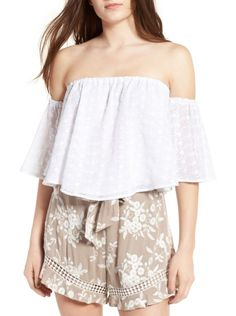 eyelet off the shoulder top by ASTR. Soak up the sunshine in this floaty, flirty off-the-shoulder top detailed with sweet floral embroidery and breezy eye...