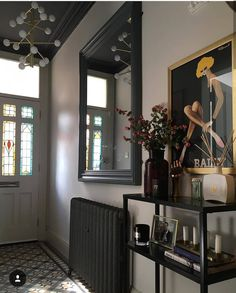 Stylish hallway interiors with dark wall mirror and dark painted cast iron radiator. Hallway Mirror, Dark Hallway, Mirrors, Hallway Decorating, Entryway Decor, Hallway Inspiration, Hallway Ideas, Hallway Designs, Mad About The House
