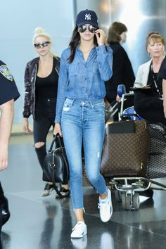 Kendall Jenner tries to blend in at the airport, but her effortless Canadian tuxedo makes a statement.   - HarpersBAZAAR.com