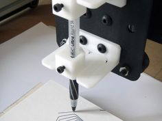 Hello!    I've made this pen holder that allows a slight movement in the Z-axis direction with minimal translation in X and Y. It's the same part printed twice and installed on the mounting plate using M5 screws. There is space for a small bolt and nut to be inserted in the front side, to fix the pen. The maximum pen diameter that can be inserted is 12.5 mm.    It needs to be printed flat so it's stronger in flexion!   I hope it could be useful.   Cheers!