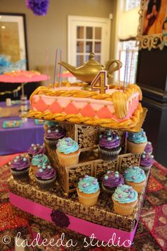 A gorgeous cake display topped with a genie lamp makes this a beautiful setup for an Arabian Nights birthday party. www.ladeedastudio.com