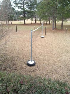 Volleyball post from a tire posts homemade and volleyball for Homemade basketball court