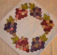 Hello Everyone, The hexie grapes are finished. They just need to be appliqued to the background, and the center for this quilt is fi. Hexagon Quilt Pattern, Quilt Patterns, English Paper Piecing, Barn Quilts, Mini Quilts, Quilting Tutorials, Applique Quilts, Quilt Blocks, Creations