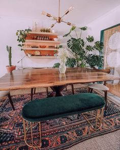 a mid century modern meets boho dining room with a live edge table, a boho rug, . - a mid century modern meets boho dining room with a live edge table, a boho rug, a forest green otto - Dining Room Lamps, Dining Room Design, Dining Room With Rug, Bench Dining Room Table, Green Dining Room, Bungalow Dining Room, Dining Table With Bench, Dining Decor, Modern Dining Benches