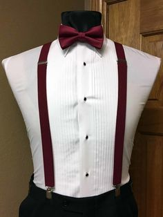 Nampa based tuxedo shop specializing in purchase and rental of formal ware. Wool and polyester tuxedos suits satin tuxedo vests tuxedo and dress pants suspenders with matching bow ties and 1 patent leather shoes. 1 stop formal shop White Tuxedo Wedding, Navy And Burgundy Wedding, Burgundy Bow Tie, Groom Attire, Groom And Groomsmen, Groom Tuxedo, Suit With Suspenders, Wedding Suspenders, Quince Dresses