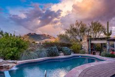 Scottsdale Scottsdale AZ Home For Sale  $960,000, 3 Beds, 3 Baths, 3,429 Sqr Feet  Terravita's finest~an ENTERTAINER'S DELIGHT! A stunning property completely remodeled inside & out. Two master suites each with beautifully appointed bathrooms w/ Travertine tile flooring, bath tub & showers w/ seamless glass enclosures; & each with a seperate outdoor patio with water feature & fire  http://mikebruen.sreagent.com/property/22-5551622-6598-E-Crested-Saguaro-Lane-Scottsdale-AZ-85266&ht=..