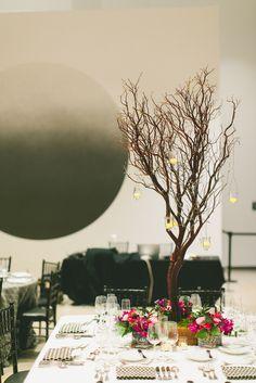 Beautiful centerpieces with Manzinita Trees and Bright Florals #YourEventFlorist  #ArizonaWeddings  Photography: Mike Olbinski, Wedding Planner: Outstanding Occasions, Florist: Your Event Florist.