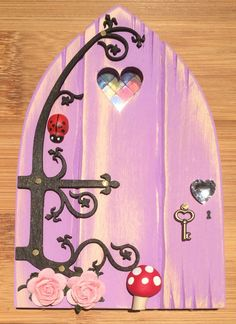 Oaktree Fairies - The Welsh Fairy Door Company. Lush Lilac Fairy Door with new Fairytale hinge! www.oaktreefairies.co.uk