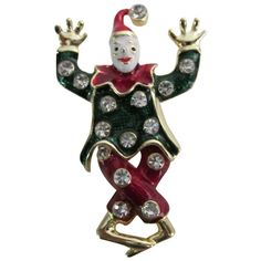 Price : $4.99 Circus Funny Cute Clown Brooch Funny Clothes Colorful Costume Jewelry Material Used : Gold Metal enamel green & red with clear crystals  Color : Green/Red  Brooch Length : 2 inches long & 1 1/4 inches wide