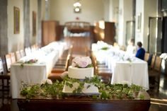 Two long tables for the guests worked great in this reception space.    Photos:  Carey Ann Photography