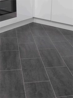 Floors Of The Week Vintage Look Black Laminate Tiles Like These But Considering Laying Tile Diagonally