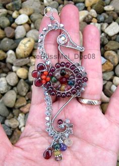 Wire wrapped, silver seahorse pendant with multicolored beads.