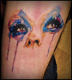 absolutely love the water colored look of this tattoo