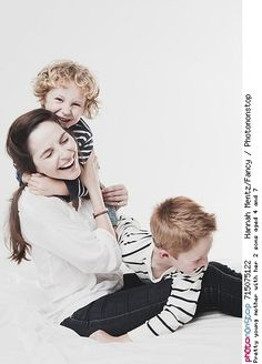 Pretty young mother with her 2 sons