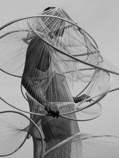 Architectural Fashion with sculptural spiralling structure encircling the body - 3D fashion; wearable art // Baiba Ladiga