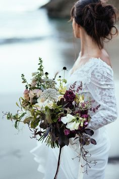 Wild flower rustic coloured bridal bouquet | Photography by http://www.sarahfalugo.com/