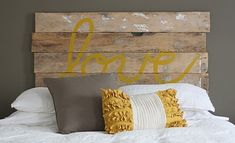 Love the rustic headboard with the our white cotton spread and mustard yellow highlights