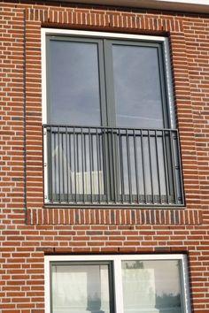 Mooi voorbeeld van kleur kozijn, kleur baksteen, metselwerk rondom kozijn, kleur metselwerk en type raam