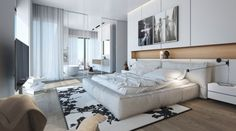 un grand lit blanc et un tapis blanc à motifs noirs dans la chambre à coucher