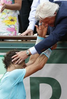 Spain's Rafael Nadal is congratulated by six-time winner Bjorn Borg of Sweden, right, after winning the final of the French Open tennis tournament against Serbia's Novak Djokovic at the Roland Garros stadium, in Paris, France, Sunday, June 8, 2014. Nadal won in four sets 3-6, 7-5, 6-2, 6-4