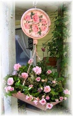 Love for roses and beautiful old stuff collide in this pretty hanging planter from an old scale.