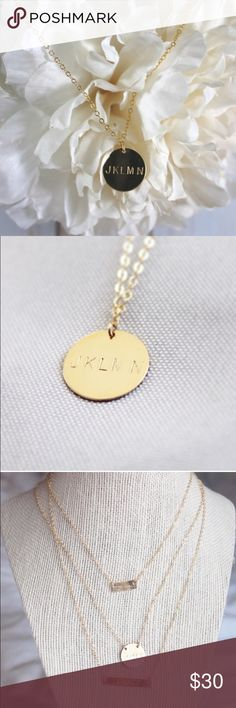 14k Gold Filled Hand Stamped Circle Charm Necklace This delicate, circle tag necklace is the perfect gift and reminder of the simple things in life. You can choose to have the circle stamped with any sequence of characters (numbers or letters).   NOTE: Please leave your word or symbol (heart and arrow stamps are available)  -Tarnish Resistant Gold Filled Materials   -Hand stamped with your choice of one letter or one heart symbol.   -14kt gold filled 1.6mm flat cable chain. (Chain length…
