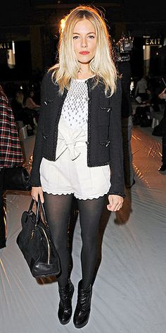 Sienna Miller in shorts with tights at the Matthew Williamson show during London Fashion Week