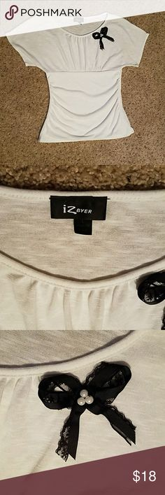 IZ Byer Cute Top Size large. Super cute top with darling black lace bow with 3 faux pearls inside of bow.  Dress up or down.  Excellent used condition. Iz Byer Tops