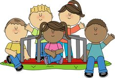 Kids sitting on a merry-go-round.