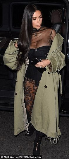 Dressed to impress: Kim Kardashian stepped out in a striking bustier teamed with lacy tights and boots in Paris on Saturday