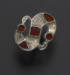 Fibula (garment pin) Frankish, 6th century, silver with garnets, Cleveland Museum of Art