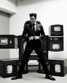 Standing with his legs apart is his thing  ohh T.O.P haha