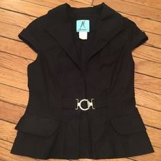 Marciano Black Vest Short sleeve black vest with gold buckle closure gives for a classy look. Perfect to wear to work then head to happy hour! Faux pockets. Runs small. Shell: 97% Cotton, 3% Spandex; Lining: 100% Polyester Marciano Jackets & Coats Vests