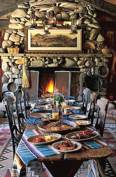 River rock fireplace in dining room of Ralph Lauren's home in Colorado.
