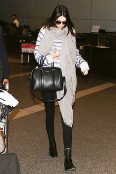 10 Times Celebrities Dressed Up The Airport Terminal #refinery29  http://www.refinery29.com/2014/11/78645/best-celebrity-travel-outfits#slide9  Kendall Jenner wears her fluffy H&M sweaters to the airport — just like us.