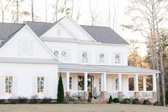 Farmhouse Exterior Christmas Decor Flocked wreaths and garland adorn windows and doorways, providing just enough contrast against the white backdrop of the house Farmhouse Exterior Christmas Decor Flocked wreaths and garlands Farmhouse Exterior Christmas Decor Flocked wreaths and garland Ideas Farmhouse Exterior Christmas Decor Flocked wreaths and garland Farmhouse Exterior Christmas Decor Flocked wreaths and garland #FarmhouseExterior #ChristmasDecor #ExteriorChristmasDecor #Flockedwreaths… Trim Paint Color, Wall Paint Colors, Sherwin Williams Extra White, Painting Trim, White Backdrop, Visual Comfort, Curb Appeal, House Tours, Beautiful Homes