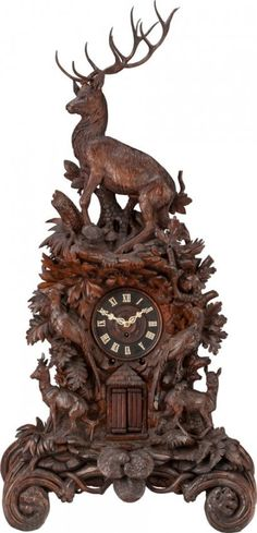 62495: A LARGE BLACK FOREST CARVED WOOD AND IVORY MANTLE CLOCK