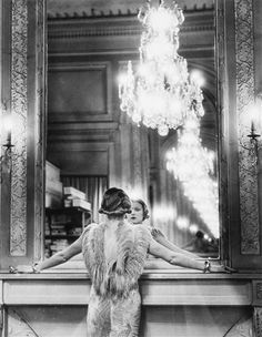 Alfred Eisenstaedt - Model Looking in Huge Mirror of Paris Fashion Designer Edward Molyneux; Creation Date: 1937; Medium: Gelatin silver print;...