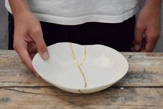 Beautiful handmade white porcelain kintsugi bowl with gold repair #kintsugi #beautiful #perfectlyimperfect #gold #hollyandco