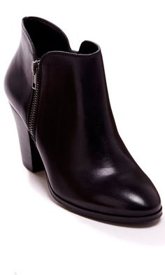 Bootie with zipper hardware, stacked heel and an easy side zipper closure.
