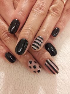 Cool Black and White Gel Nails with Designs.
