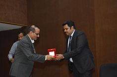 Shri Rajat Srivastava is being presented a memento by a member of CMIA