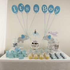 Elephant Baby Shower Theme for Baby Boy - Includes cupcake toppers, banner, sign, gift tags, encouragement cards, advice bookmarks. This item also comes for in a pink for a baby girl.