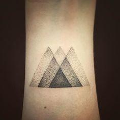 Details. Little triangles for Erin. Handpoked in Reykjavík Iceland. #dotwork… More